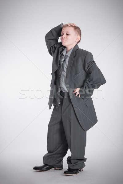 Drôle garçon grand affaires costume noir Photo stock © a2bb5s