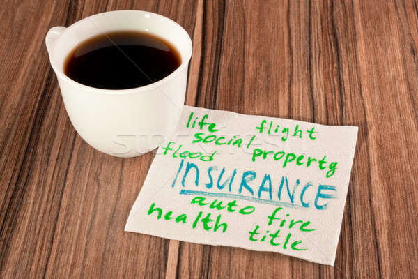 Stock photo: Insurance on a napkin
