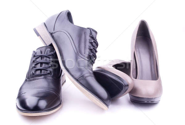 Stock photo: A pair of men's and women's shoes