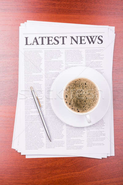 The newspaper LATEST NEWS on table  and coffee Stock photo © a2bb5s