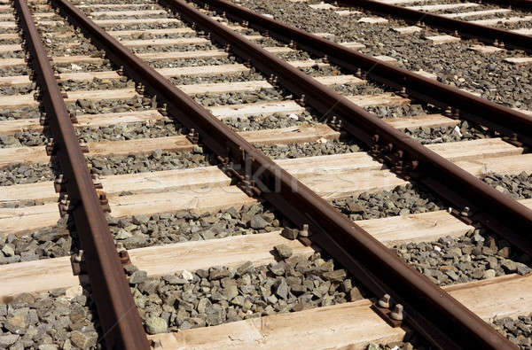 Rails sleepers and stones background. Stock photo © ABBPhoto