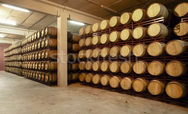 Wine barrels in an aging cellar Stock photo © ABBPhoto