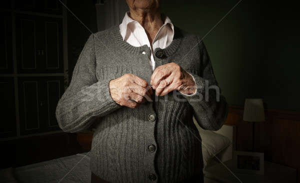 Stock photo: Old hands buttoning.