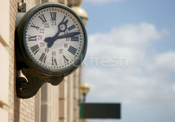 Outdoor analog clock in a railway station Stock photo © ABBPhoto