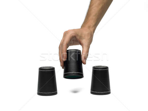 Dice cup with hand Stock photo © ABBPhoto