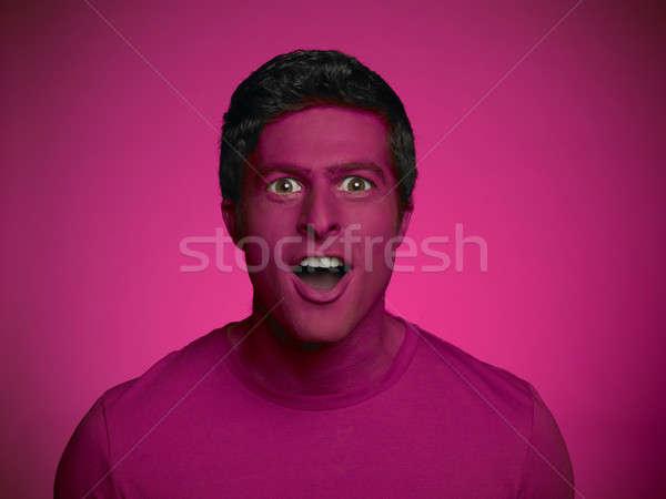 Verwonderd man gelukkig jonge man extra grote ogen Stockfoto © ABBPhoto