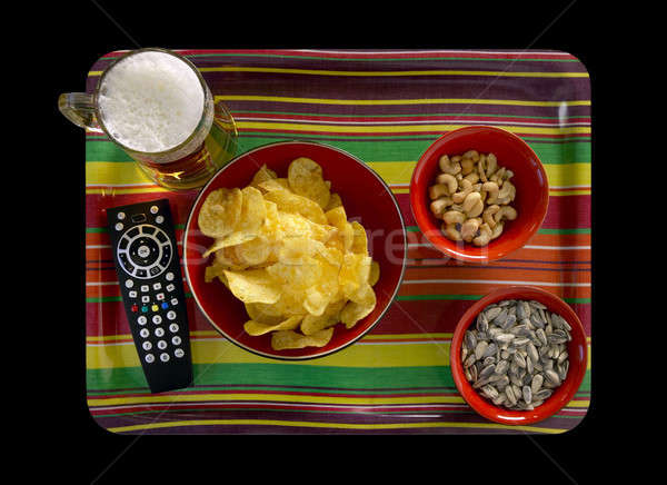 Remote tv control with snacks Stock photo © ABBPhoto