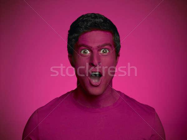 Surprised youn man Stock photo © ABBPhoto