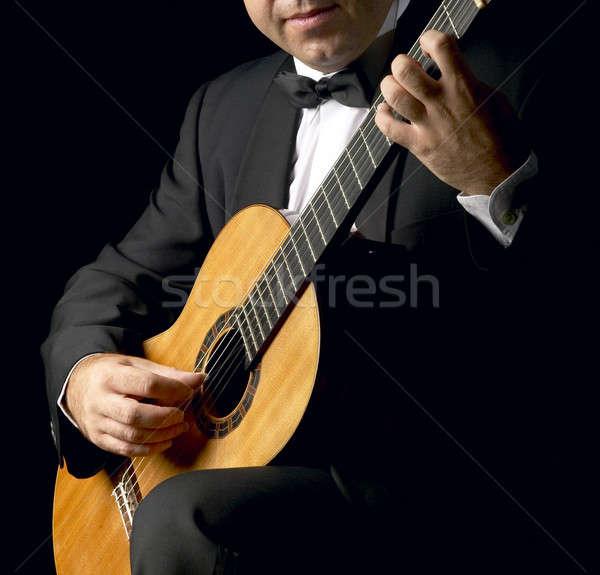 Klasszikus gitáros dohányzás kabát alacsony kulcs Stock fotó © ABBPhoto