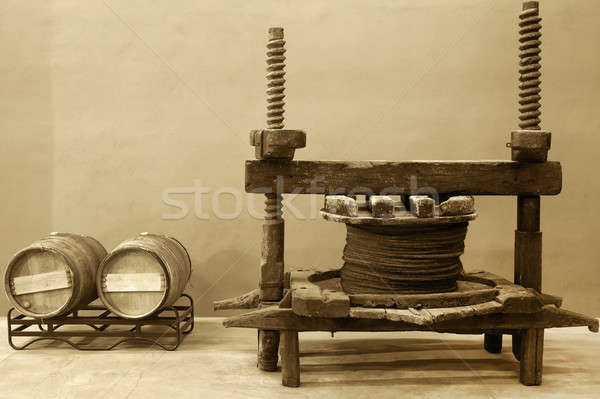 Wine barrels and old cellar press system Stock photo © ABBPhoto
