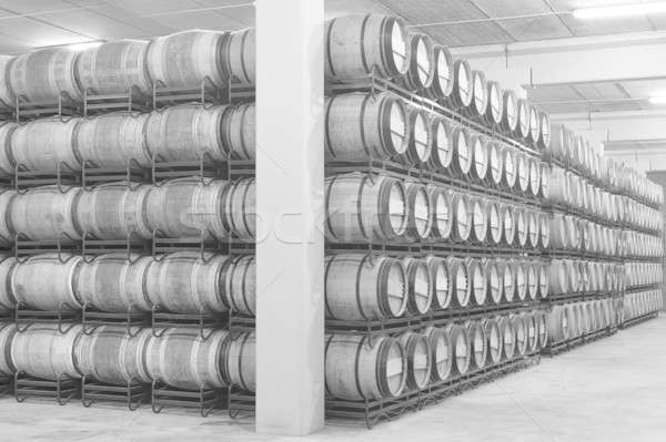 Wine barrels in an aging cellar Stock photo © ABBPhoto