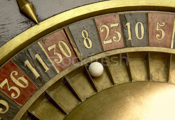 Playing on a vintage roulette Stock photo © ABBPhoto