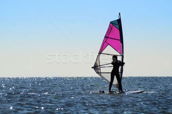 Silhouette of a girl windsurfer Stock photo © acidgrey