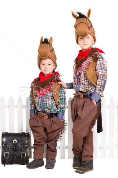 Dos ninos caballo posando cerca Foto stock © acidgrey