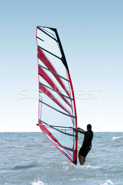 Silhouette of a windsurfer on waves of a sea 2  Stock photo © acidgrey