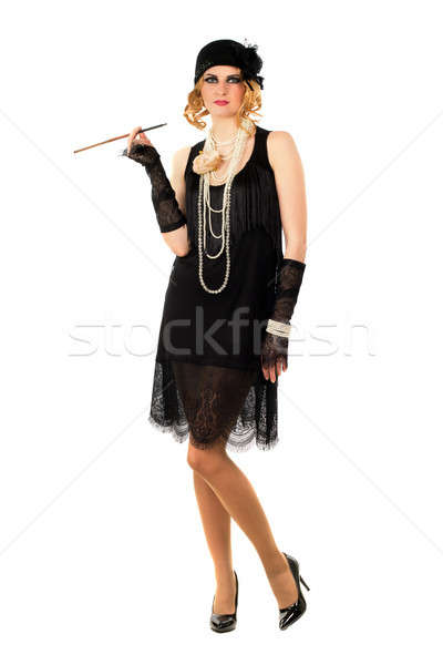 Young woman with a cigarette holder Stock photo © acidgrey