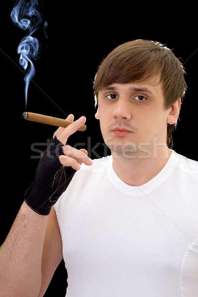 Moço charuto isolado preto fumar jovem Foto stock © acidgrey