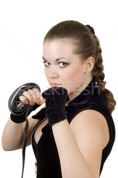 Pretty angry young woman throwing a punch. Isolated Stock photo © acidgrey