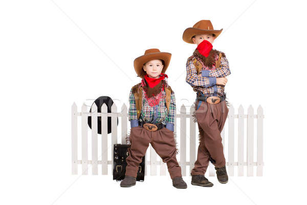 Stock photo: Two boys wearing cowboy costumes
