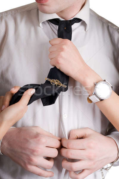 Young man, a tie and female hands. Isolated Stock photo © acidgrey