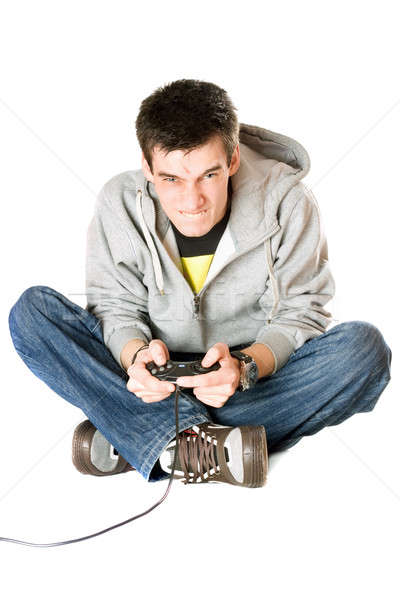 Furious young man with a joystick for game console Stock photo © acidgrey