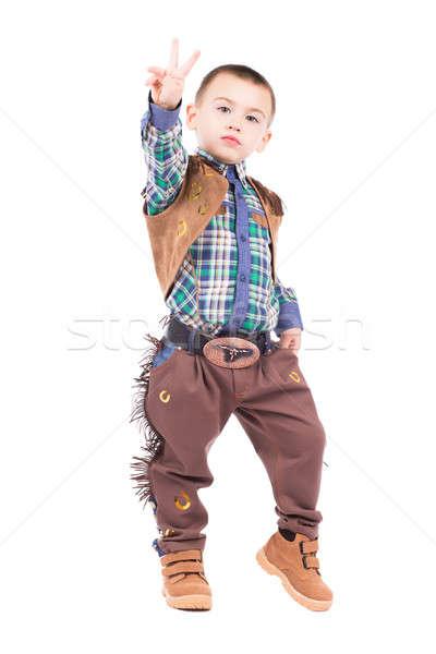 Little boy posing in cowboy costumes Stock photo © acidgrey