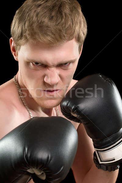 Wściekły młody człowiek rękawice bokserskie odizolowany czarny twarz Zdjęcia stock © acidgrey