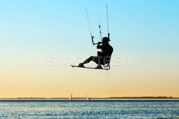Silhouette of a kitesurfer Stock photo © acidgrey