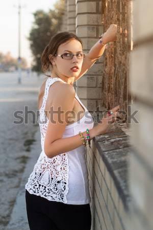 Young flirty woman Stock photo © acidgrey