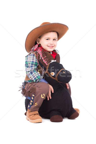Uśmiechnięty mały cowboy stwarzające zabawki konia Zdjęcia stock © acidgrey