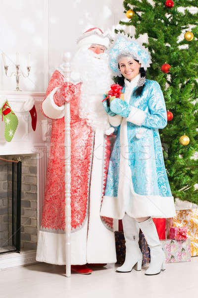 Stock photo: Snow maiden and santa claus