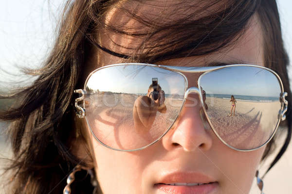 Reflexion of the photographer in model glasses Stock photo © acidgrey