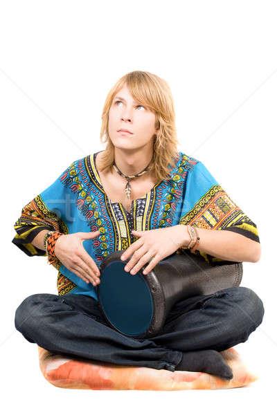 The young man plays a drum looking upwards Stock photo © acidgrey