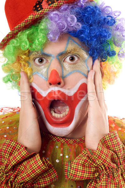 Portrait of a terrified clown Stock photo © acidgrey