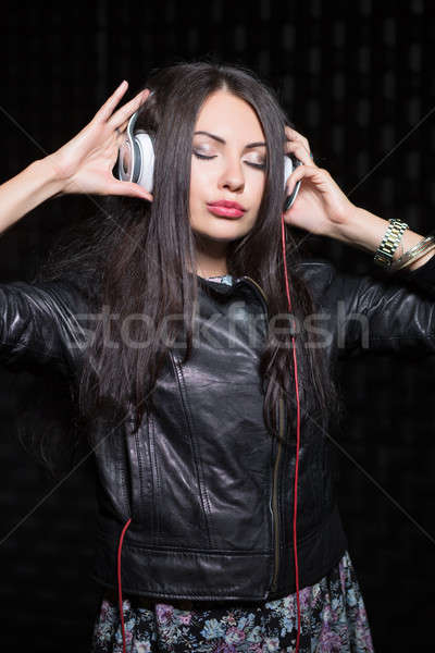 Young brunette posing with headphones Stock photo © acidgrey