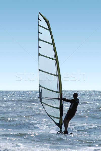 Silhouette of a windsurfer on a sea  Stock photo © acidgrey