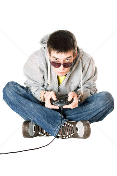 Young man in sunglasses with a joystick Stock photo © acidgrey