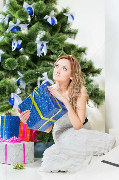 álomszerű fiatal nő ül karácsony ajándék otthon Stock fotó © acidgrey