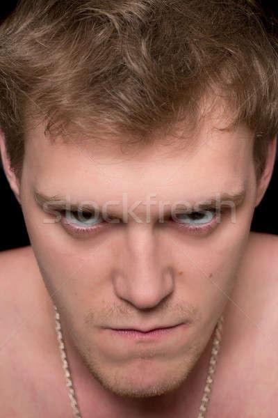 Portré szeszélyes fiatalember közelkép izolált fekete Stock fotó © acidgrey