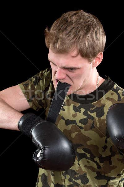 Wściekły młody człowiek rękawice bokserskie odizolowany twarz sportu Zdjęcia stock © acidgrey