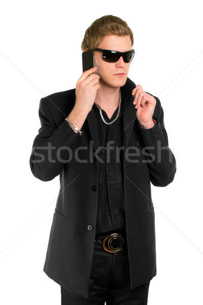 Young man in sunglasses with a phone Stock photo © acidgrey