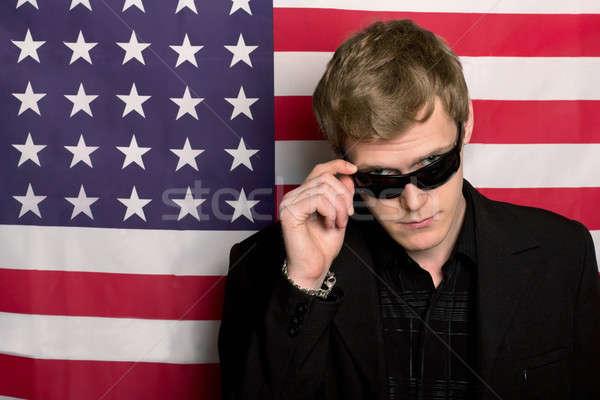 Poważny człowiek okulary amerykańską flagę biznesmen banderą Zdjęcia stock © acidgrey