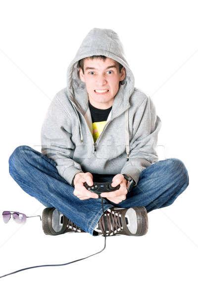 Fiatalember botkormány játék konzol férfi videó Stock fotó © acidgrey