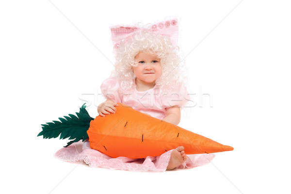 Funny baby girl plays with a carrot Stock photo © acidgrey