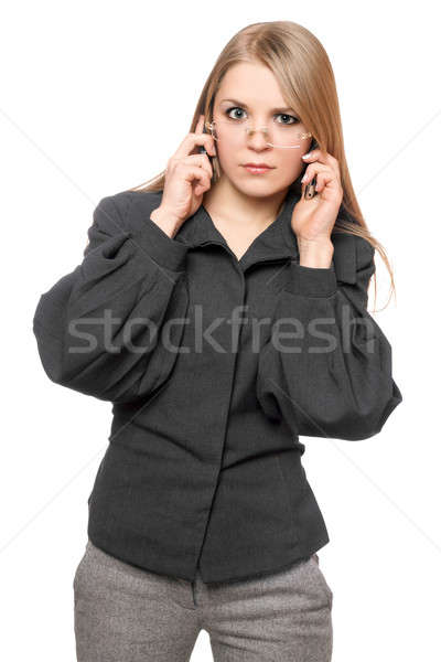 Portrait of discontented young blonde in a gray business suit Stock photo © acidgrey