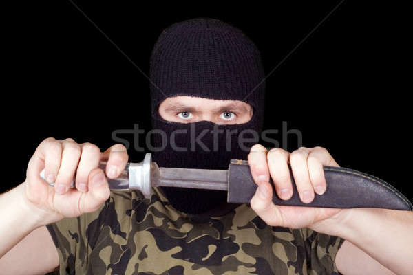 Portrait of  the man with a knife over black Stock photo © acidgrey