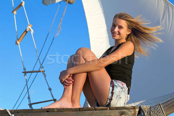 teen girl sitting at stern of the ship Stock photo © acidgrey
