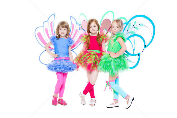 Három kislányok pózol színes pillangó ruha Stock fotó © acidgrey