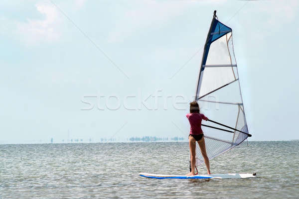 Silhouette of a girl windsurfer Stock photo © acidgrey