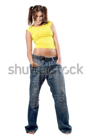Young nice girl in jeans Stock photo © acidgrey